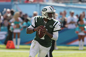 Quarterback Geno Smith of the New York Jets rolls out against the Miami Dolphins at Sun Life Stadium on December 28 2014 in Miami Gardens Florida