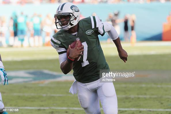 Quarterback Geno Smith of the New York Jets runs the ball against the Miami Dolphins at Sun Life Stadium on December 28 2014 in Miami Gardens Florida