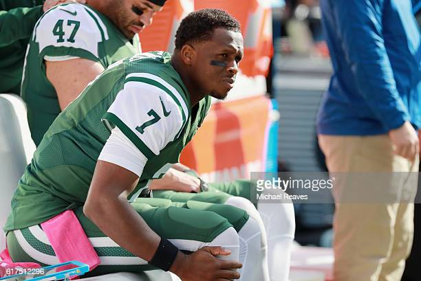 Quarterback Geno Smith of the New York Jets sits on the sidelines after being taken out of the game due to an injury during the second quarter...