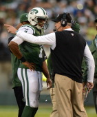 Quarterback Geno Smith of the New York Jets talks to head coach Rex Ryan of the New York Jets in the second half of against the Cleveland Browns at...