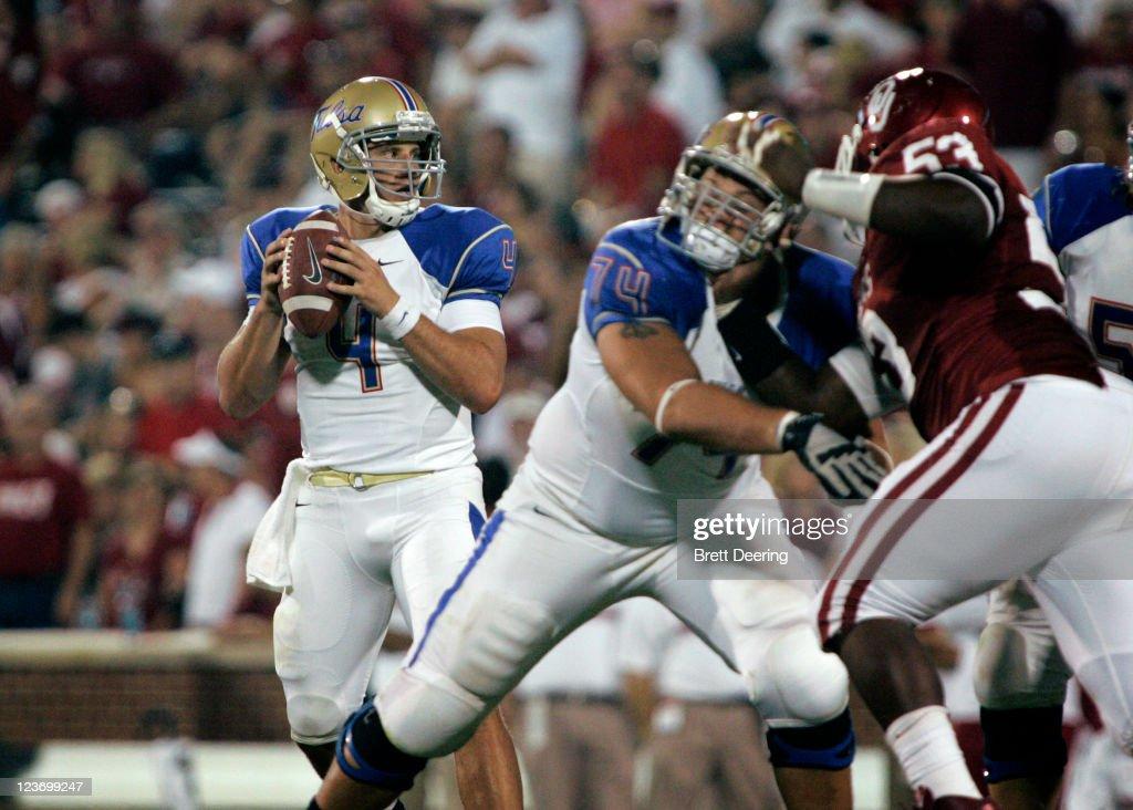 Quarterback G.J. Kinne #4 of the Tulsa Hurricanes looks to throw under ...