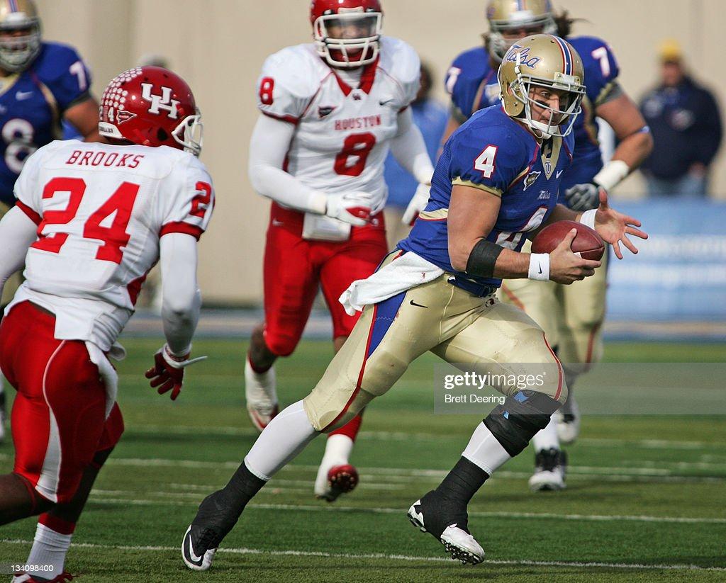 Quarterback G.J. Kinne #4 of the Tulsa Hurricanes scrambles in the ...