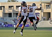 Quarterback Graham Harrell of the Texas Tech Red Raiders celebrates after scoring a fourth quarter touchdown with teammate Michael Crabtree during a...