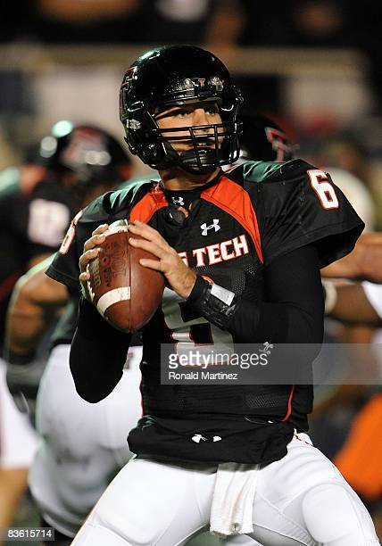 Quarterback Graham Harrell of the Texas Tech Red Raiders drops back to pass against the Oklahoma State Cowboys at Jones ATT Stadium on November 8...