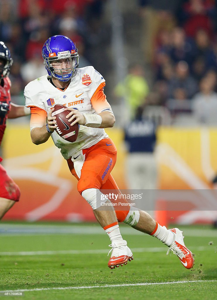Quarterback <a gi-track='captionPersonalityLinkClicked' href=/galleries/search?phrase=Grant+Hedrick&family=editorial&specificpeople=7159943 ng-click='$event.stopPropagation()'>Grant Hedrick</a> #9 of the Boise State Broncos drops back to pass during the against the Arizona Wildcats Vizio Fiesta Bowl at University of Phoenix Stadium on December 31, 2014 in Glendale, Arizona.