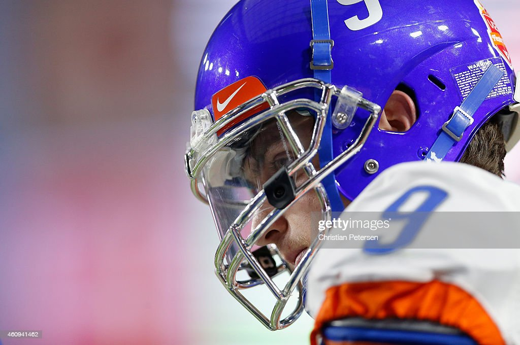 Quarterback <a gi-track='captionPersonalityLinkClicked' href=/galleries/search?phrase=Grant+Hedrick&family=editorial&specificpeople=7159943 ng-click='$event.stopPropagation()'>Grant Hedrick</a> #9 of the Boise State Broncos stands on the sidelines during the Vizio Fiesta Bowl against the Arizona Wildcats at University of Phoenix Stadium on December 31, 2014 in Glendale, Arizona. The Broncos defeated the Wildcats 38-30.