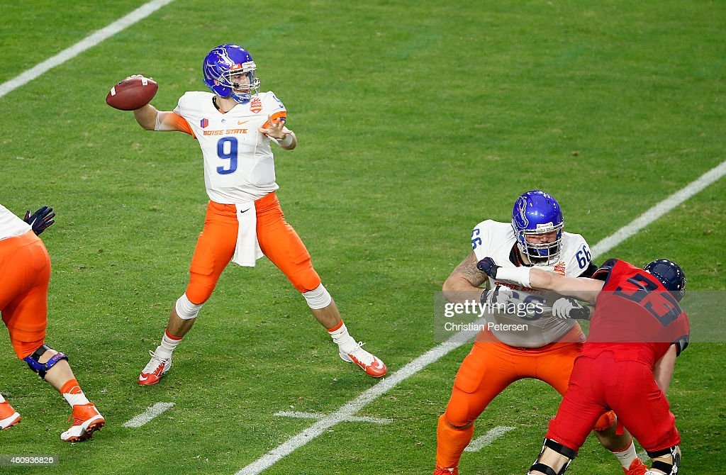Quarterback <a gi-track='captionPersonalityLinkClicked' href=/galleries/search?phrase=Grant+Hedrick&family=editorial&specificpeople=7159943 ng-click='$event.stopPropagation()'>Grant Hedrick</a> #9 of the Boise State Broncos throws a pass during the first quarter of the Vizio Fiesta Bowl against the Arizona Wildcats at University of Phoenix Stadium on December 31, 2014 in Glendale, Arizona.