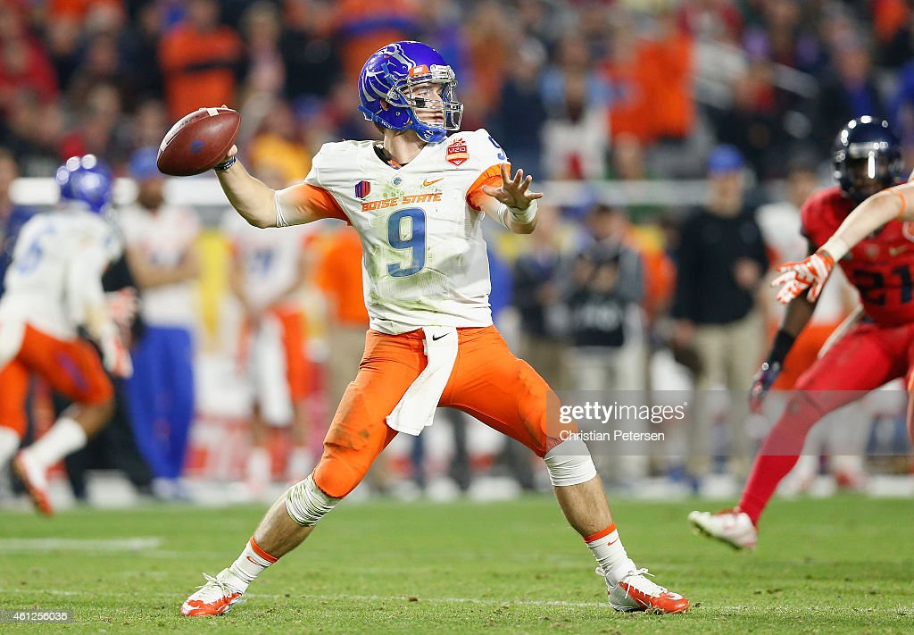 Quarterback <a gi-track='captionPersonalityLinkClicked' href=/galleries/search?phrase=Grant+Hedrick&family=editorial&specificpeople=7159943 ng-click='$event.stopPropagation()'>Grant Hedrick</a> #9 of the Boise State Broncos throws a pass during the Vizio Fiesta Bowl at University of Phoenix Stadium on December 31, 2014 in Glendale, Arizona.
