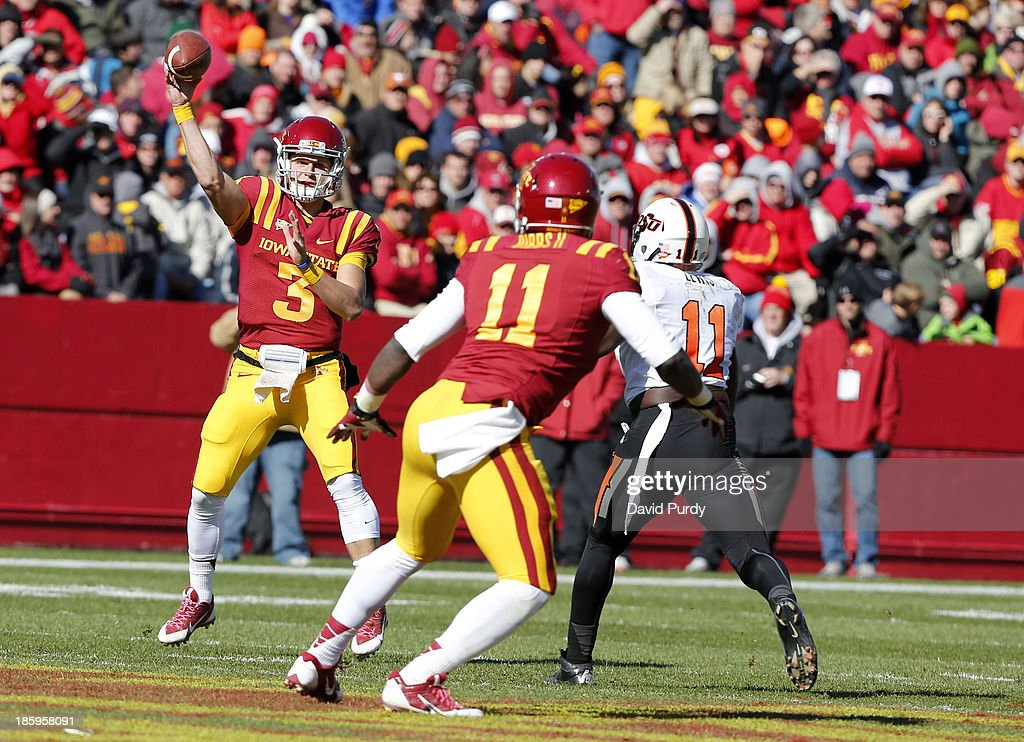 Quarterback Grant Rohach #3 of the Iowa State Cyclones passes to tight end E.J. Bibbs #11 of the Iowa State Cyclones as linebacker Shaun Lewis #11 of the Oklahoma State Cowboys defends in the first half of play at Jack Trice Stadium on October 26, 2013 in Ames, Iowa. The Oklahoma State Cowboys defeated the Iowa State Cyclones 58-27.
