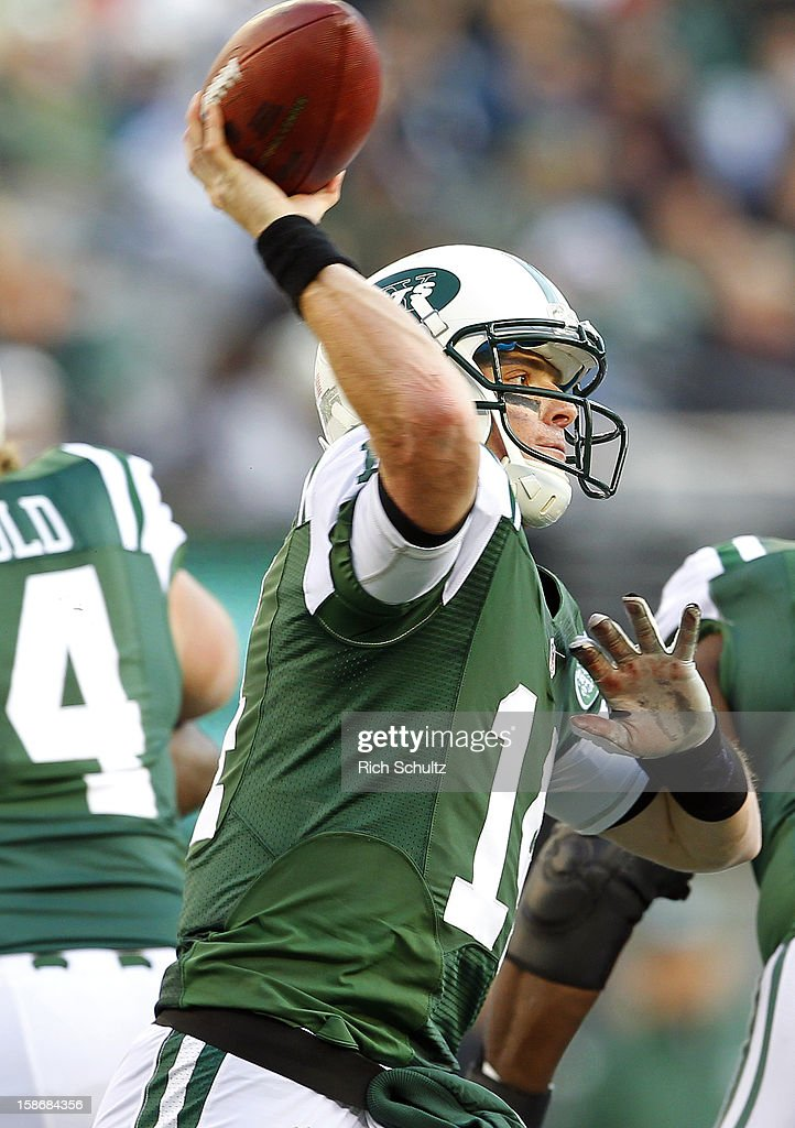 Quarterback <a gi-track='captionPersonalityLinkClicked' href=/galleries/search?phrase=Greg+McElroy&family=editorial&specificpeople=5534586 ng-click='$event.stopPropagation()'>Greg McElroy</a> #14 of the New York Jets looks to pass against the San Diego Chargers during the first half at MetLife Stadium on December 23, 2012 in East Rutherford, New Jersey. The Chargers defeated the Jets 27-17.