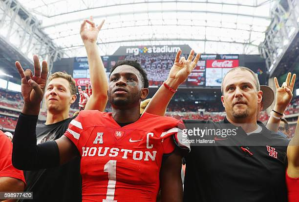 Quarterback Greg Ward Jr #1 of the Houston Cougars celebrates with his coach Tom Herman after they defeated the Oklahoma Sooners 3323 during the...