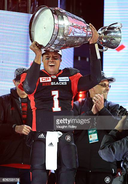 Quarterback Henry Burris of the Ottawa Redblacks hoists the Grey Cup following the 104th Grey Cup Championship Game against the Calgary Stampeders at...