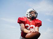 Quarterback holding football