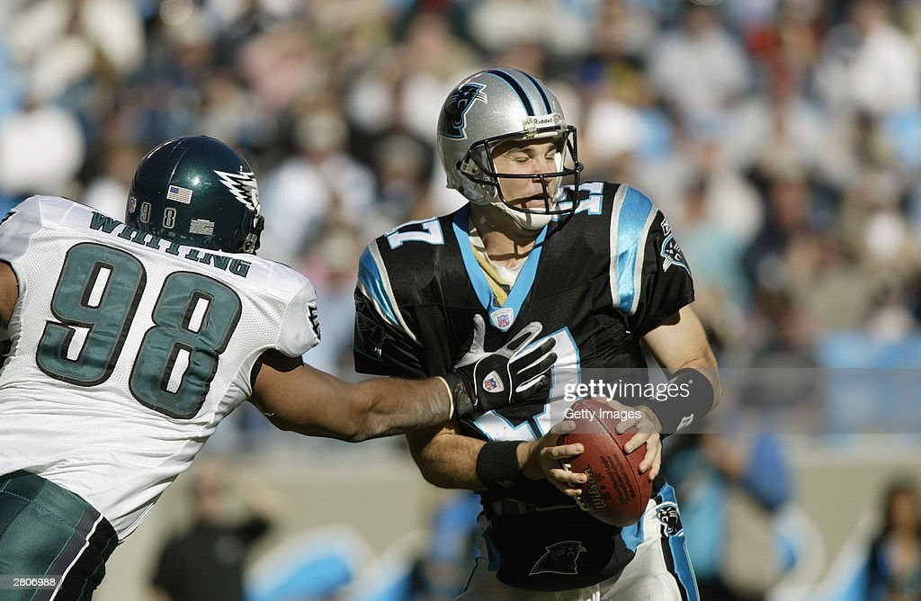 Quarterback Jack Delhomme #17 of the Carolina Panthers is sacked by Brandon Whiting #98 of the Philadelphia Eagles during the game on November 30, 2003 at Ericsson Stadium in Charlotte, North Carolina. The Eagles defeated the Panthers 25-15.