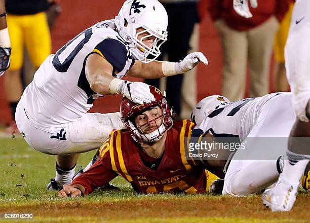 Quarterback Jacob Park of the Iowa State Cyclones fights for the ball he fumbled with linebacker Justin Arndt and defensive lineman Noble Nwachukwu...