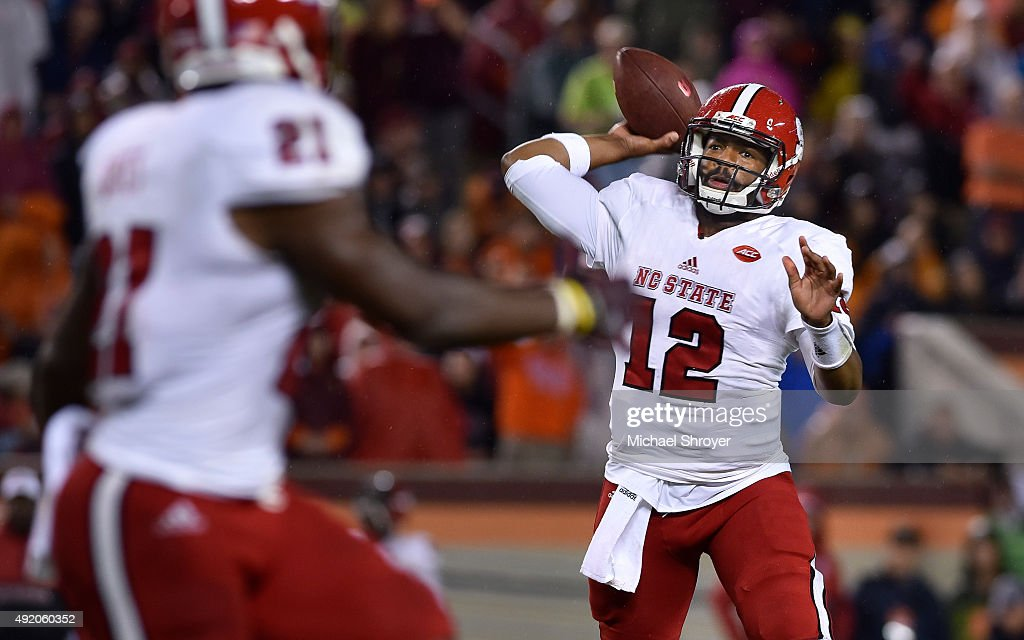 Quarterback Jacoby Brissett #12 of the North Carolina State Wolfpack attempts a pass against the Virginia Tech Hokies in the first half at Lane Stadium on October 9, 2015 in Blacksburg, Virginia.