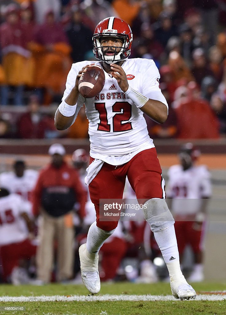 Quarterback <a gi-track='captionPersonalityLinkClicked' href=/galleries/search?phrase=Jacoby+Brissett&family=editorial&specificpeople=8489613 ng-click='$event.stopPropagation()'>Jacoby Brissett</a> #12 of the North Carolina State Wolfpack looks to pass against the Virginia Tech Hokies in the first half on October 9, 2015 in Blacksburg, Virginia. Virginia Tech defeated North Carolina State 28-13.
