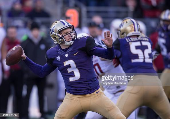 Quarterback Jake Browning of the Washington Huskies passes the ball during the first half of a football game at Husky Stadium on November 27 2015 in...