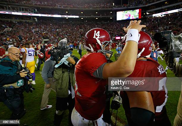 Quarterback Jake Coker and Anthony Averett of the Alabama Crimson Tide celebrate their 3016 win over the LSU Tigers at BryantDenny Stadium on...