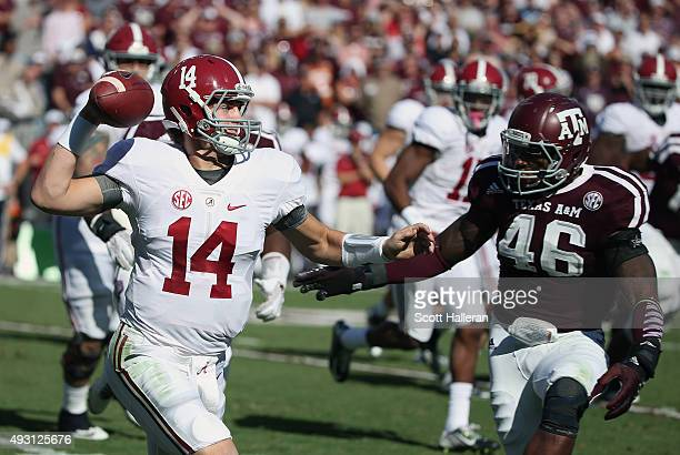 Quarterback Jake Coker of the Alabama Crimson Tide looks to throw a pass as AJ Hilliard of the Texas AM Aggies defends in the first half of their...