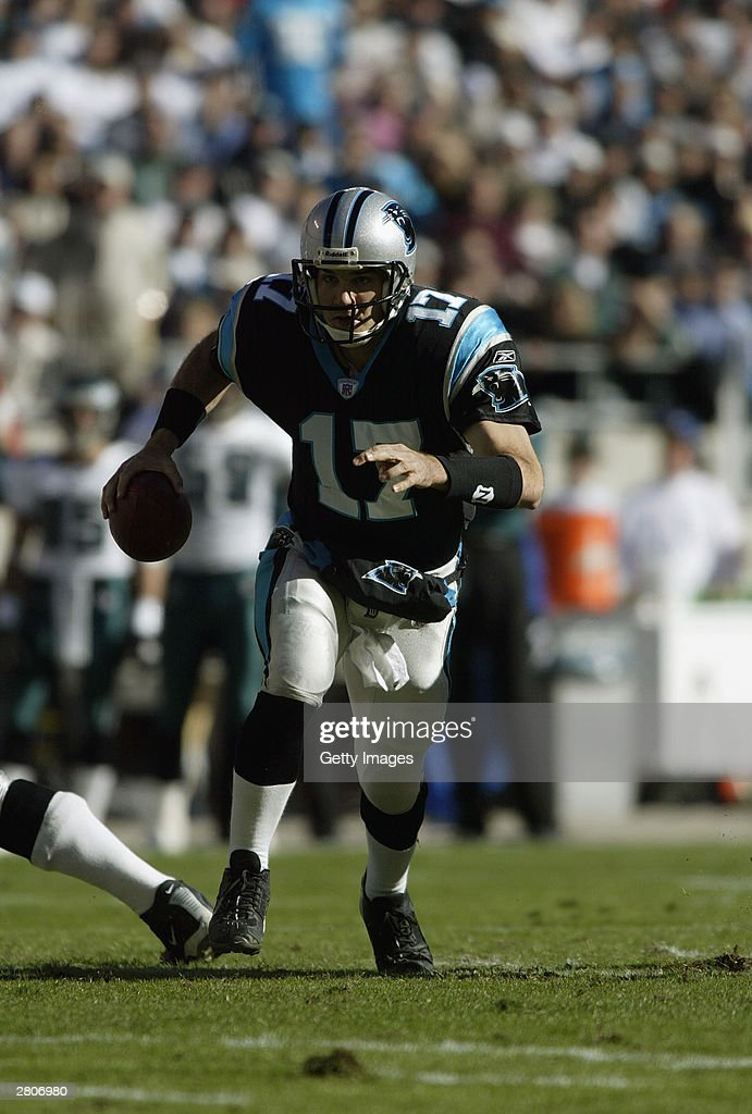 Quarterback Jake Delhomme #17 of the Carolina Panthers carries the ball during the game against the Philadelphia Eagles on November 30, 2003 at Ericsson Stadium in Charlotte, North Carolina. The Eagles defeated the Panthers 25-15.