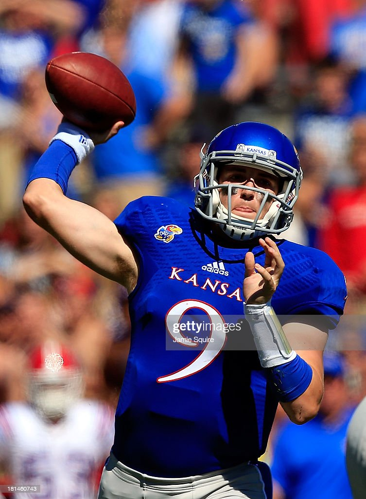 Quarterback Jake Heaps #9 of the Kansas Jayhawks passes during the game against the Louisiana Tech Bulldogs at Memorial Stadium on September 21, 2013 in Lawrence, Kansas.