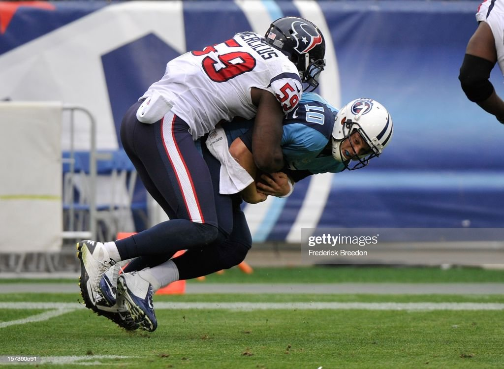 Quarterback <a gi-track='captionPersonalityLinkClicked' href=/galleries/search?phrase=Jake+Locker&family=editorial&specificpeople=4450185 ng-click='$event.stopPropagation()'>Jake Locker</a> #10 of the Tennessee Titans is sacked by Whitney Mercilus #59 of the Houston Texans at LP Field on December 2, 2012 in Nashville, Tennessee.