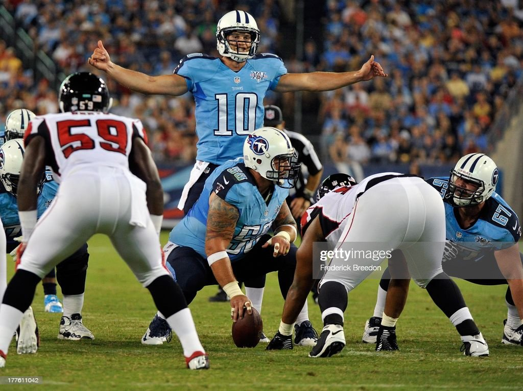 Quarterback <a gi-track='captionPersonalityLinkClicked' href=/galleries/search?phrase=Jake+Locker&family=editorial&specificpeople=4450185 ng-click='$event.stopPropagation()'>Jake Locker</a> #10 of the Tennessee Titans makes an audible call against the Atlanta Falconsat LP Field on August 24, 2013 in Nashville, Tennessee.