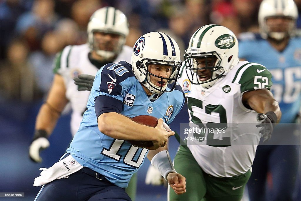Quarterback Jake Locker #10 of the Tennessee Titans runs with the ball against inside linebacker David Harris #52 of the New York Jets at LP Field on December 17, 2012 in Nashville, Tennessee.