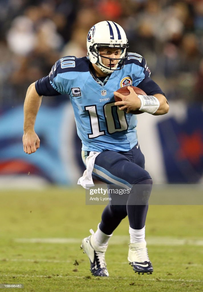 Quarterback <a gi-track='captionPersonalityLinkClicked' href=/galleries/search?phrase=Jake+Locker&family=editorial&specificpeople=4450185 ng-click='$event.stopPropagation()'>Jake Locker</a> #10 of the Tennessee Titans runs with the ball against the New York Jets at LP Field on December 17, 2012 in Nashville, Tennessee.