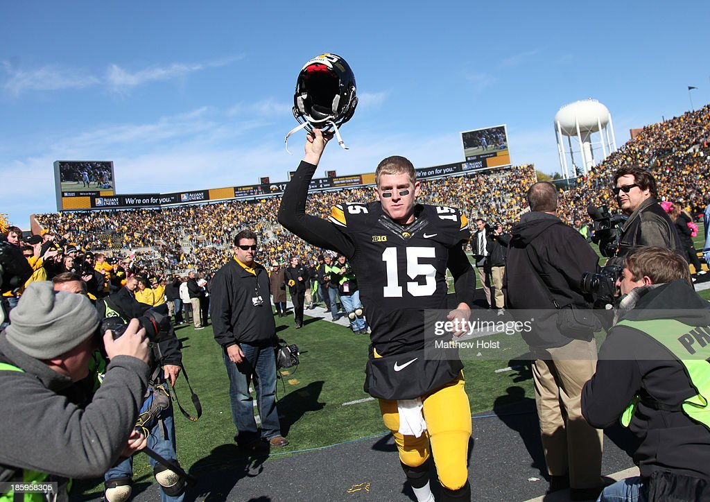 Quarterback Jake Rudock #15 of the Iowa Hawkeyes holds his helmet in the air as he leaves the field following the match-up against the Northwestern Wildcats on October 26, 2013 at Kinnick Stadium in Iowa City, Iowa. Iowa won 17-10.