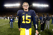 Quarterback Jake Rudock of the Michigan Wolverines walks off the field after being defeated by the Michigan Wolverines 2723 in the college football...