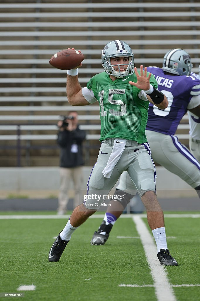 Quarterback Jake Waters #15 of the Kansas State Wildcats drops back to pass during the Purple and White Spring Game on April 27, 2013 at Bill Snyder Family Stadium in Manhattan, Kansas.