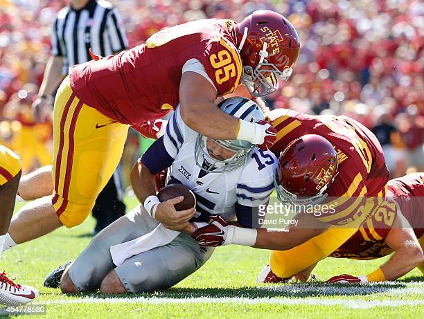 Quarterback Jake Waters of the Kansas State Wildcats is sacked by defensive lineman Robby Garcia of the Iowa State Cyclones and defensive end...