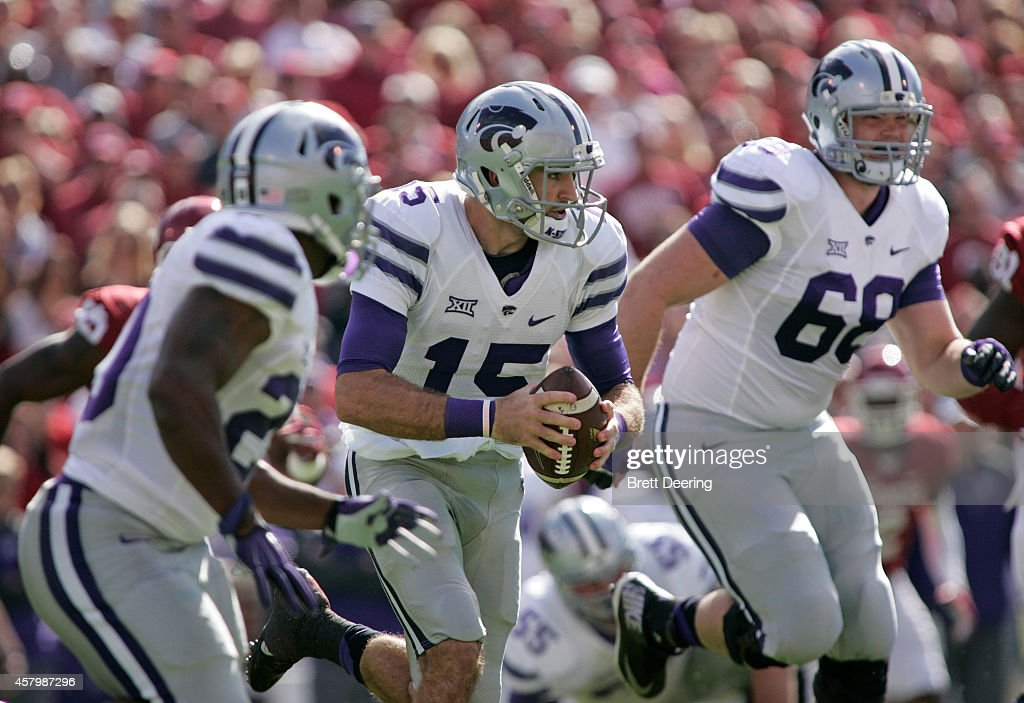 Quarterback <a gi-track='captionPersonalityLinkClicked' href=/galleries/search?phrase=Jake+Waters&family=editorial&specificpeople=10875996 ng-click='$event.stopPropagation()'>Jake Waters</a> #15 of the Kansas State Wildcats looks for a hole against the Oklahoma Sooners October 18, 2014 at Gaylord Family-Oklahoma Memorial Stadium in Norman, Oklahoma. The Wildcats defeated the Sooners 31-30.