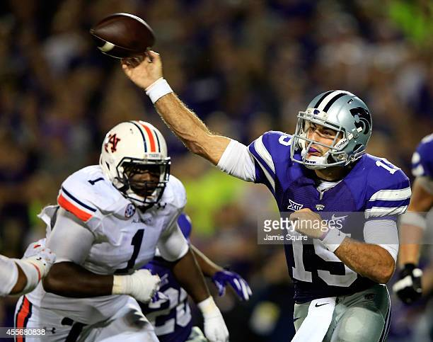 Quarterback Jake Waters of the Kansas State Wildcats passes as defensive tackle Montravius Adams of the Auburn Tigers rushes during the second half...