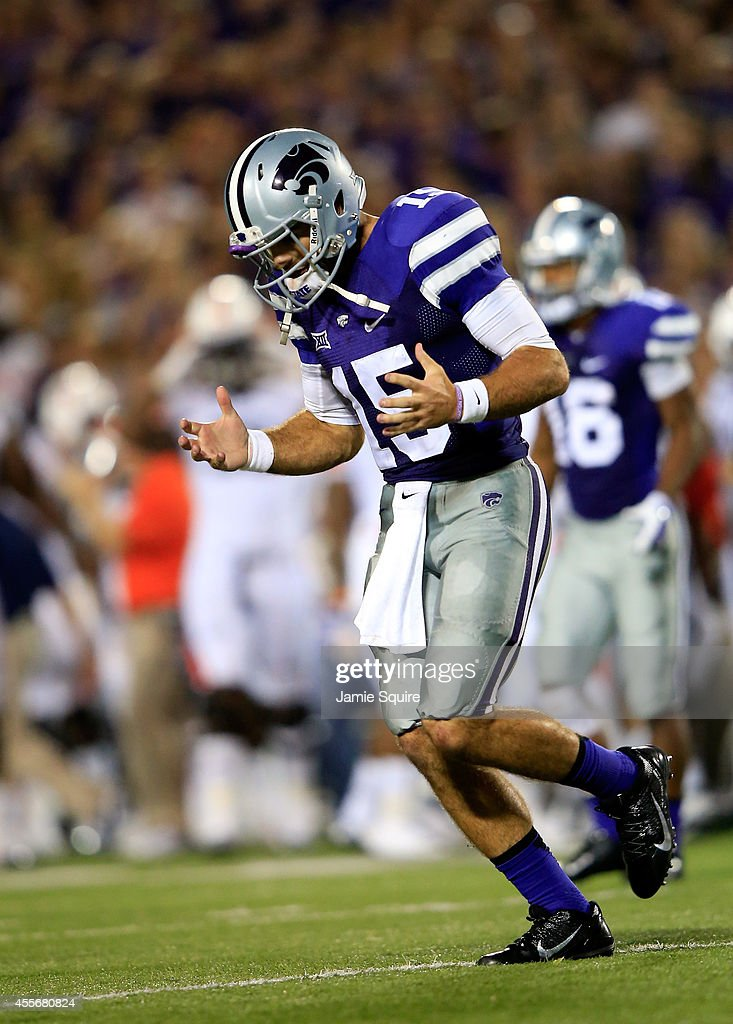Quarterback <a gi-track='captionPersonalityLinkClicked' href=/galleries/search?phrase=Jake+Waters&family=editorial&specificpeople=10875996 ng-click='$event.stopPropagation()'>Jake Waters</a> #15 of the Kansas State Wildcats reacts after throwing an interception during the second half of the game against the Auburn Tigers at Bill Snyder Family Football Stadium on September 18, 2014 in Manhattan, Kansas.