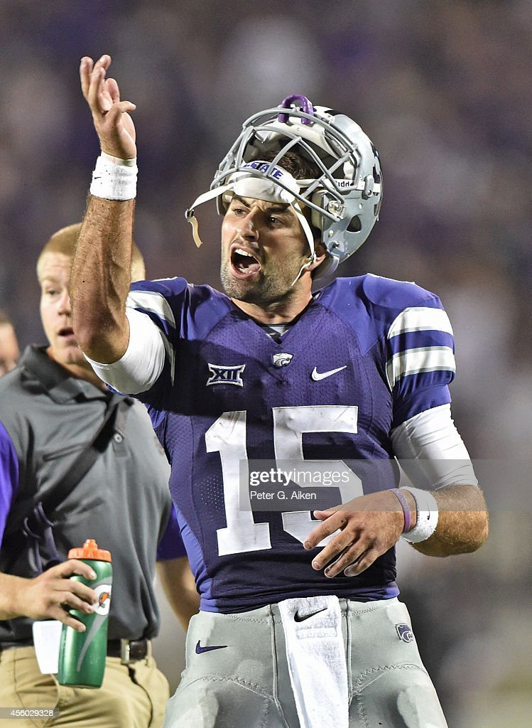 Quarterback <a gi-track='captionPersonalityLinkClicked' href=/galleries/search?phrase=Jake+Waters&family=editorial&specificpeople=10875996 ng-click='$event.stopPropagation()'>Jake Waters</a> #15 of the Kansas State Wildcats reacts during a time out during the second half against the Auburn Tigers on September 18, 2014 at Bill Snyder Family Stadium in Manhattan, Kansas.