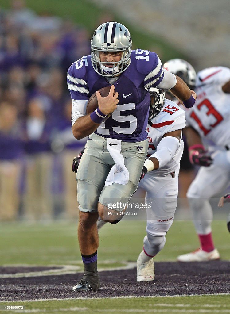 Quarterback <a gi-track='captionPersonalityLinkClicked' href=/galleries/search?phrase=Jake+Waters&family=editorial&specificpeople=10875996 ng-click='$event.stopPropagation()'>Jake Waters</a> #15 of the Kansas State Wildcats rushes up field against the Texas Tech Red Raiders during the first half on October 4, 2014 at Bill Snyder Family Stadium in Manhattan, Kansas.