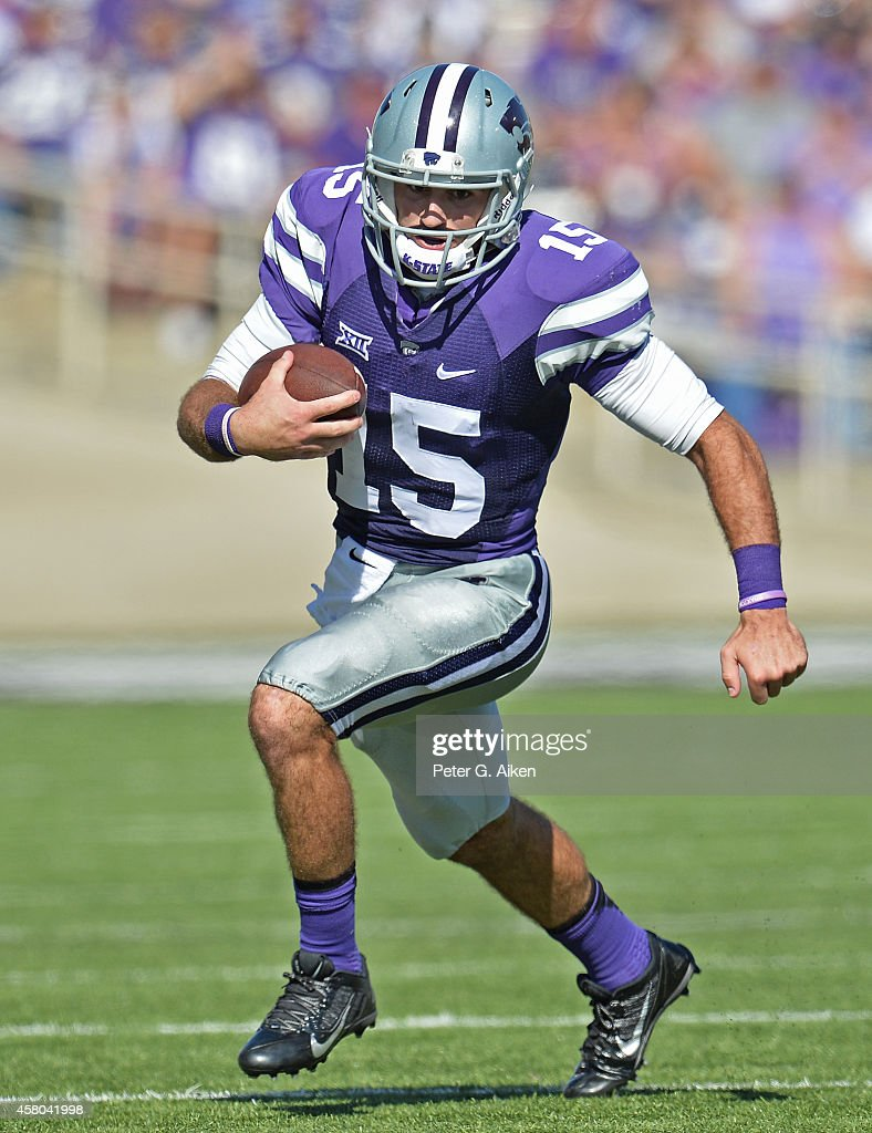 Quarterback <a gi-track='captionPersonalityLinkClicked' href=/galleries/search?phrase=Jake+Waters&family=editorial&specificpeople=10875996 ng-click='$event.stopPropagation()'>Jake Waters</a> #15 of the Kansas State Wildcats rushes up field against of the Texas Longhorns during the second half on October 25, 2014 at Bill Snyder Family Stadium in Manhattan, Kansas.