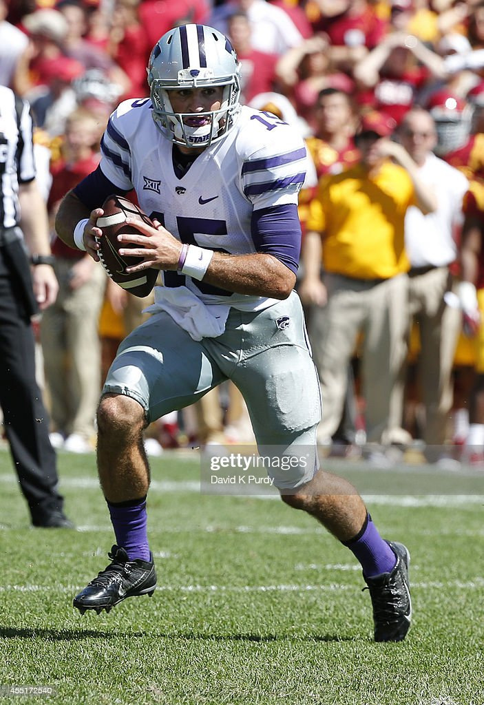 Quarterback <a gi-track='captionPersonalityLinkClicked' href=/galleries/search?phrase=Jake+Waters&family=editorial&specificpeople=10875996 ng-click='$event.stopPropagation()'>Jake Waters</a> #15 of the Kansas State Wildcats scrambles under pressure the Iowa State Cyclones in the second half of play at Jack Trice Stadium on September 6, 2014 in Ames, Iowa. Kansas State won 32-28 over the Iowa State Cyclones.