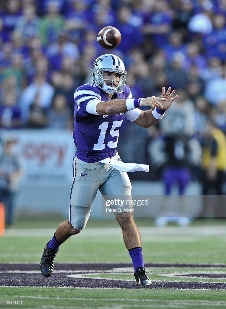 Quarterback Jake Waters #15 of the Kansas State Wildcats throws a pass down field against the TCU Horned Frogs during the first half on November 16, 2013 at Bill Snyder Family Stadium in Manhattan, Kansas. Kansas State defeated TCU 33-31.