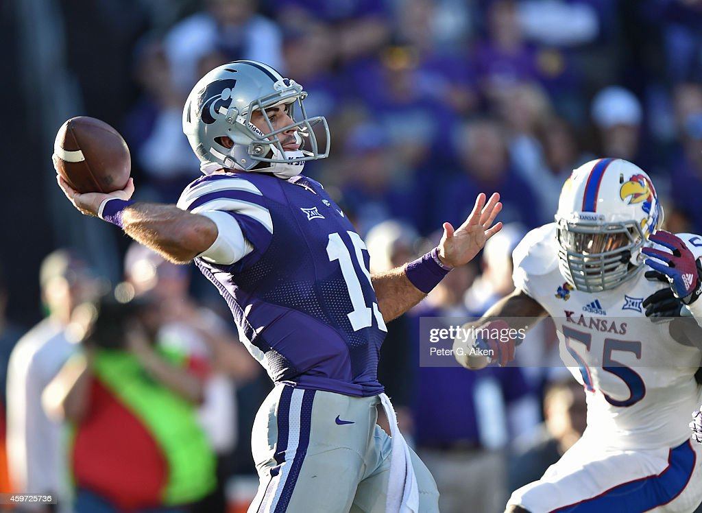 Quarterback Jake Waters of the Kansas State Wildcats throws a pass down field against the Kansas Jayhawks during the first half on November 29 2014...