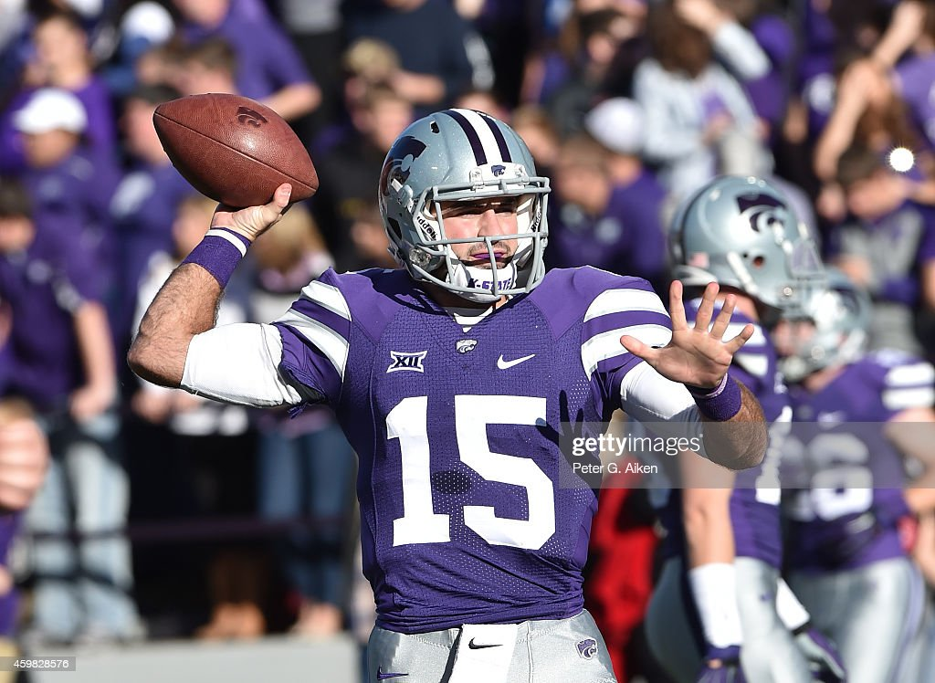 Quarterback <a gi-track='captionPersonalityLinkClicked' href=/galleries/search?phrase=Jake+Waters&family=editorial&specificpeople=10875996 ng-click='$event.stopPropagation()'>Jake Waters</a> #15 of the Kansas State Wildcats throws a pass during pre-game warm up before a game against the Kansas Jayhawks on November 29, 2014 at Bill Snyder Family Stadium in Manhattan, Kansas.