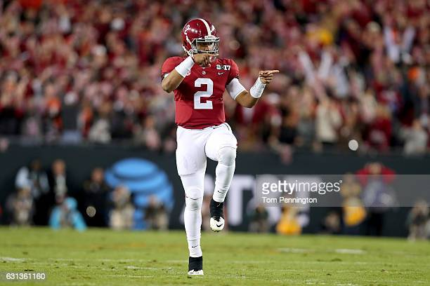 Quarterback Jalen Hurts of the Alabama Crimson Tide celebrates after a touchdown by running back Bo Scarbrough during the first quarter against the...