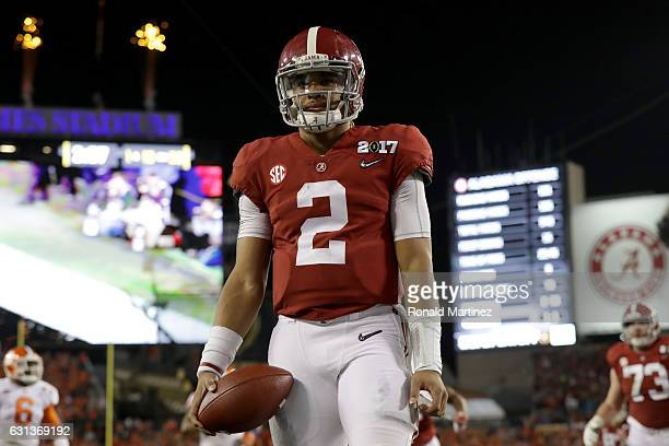 Quarterback Jalen Hurts of the Alabama Crimson Tide celebrates rushing for a 30yard touchdown during the fourth quarter against the Clemson Tigers in...