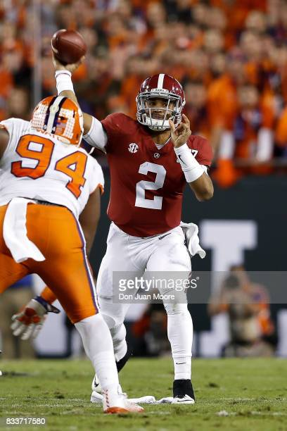 Quarterback Jalen Hurts of the Alabama Crimson Tide on a pass play over Defensive Tackle Carlos Watkins of the Clemson Tigers during the 2017 College...
