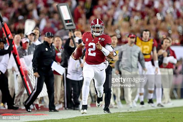 Quarterback Jalen Hurts of the Alabama Crimson Tide runs with the ball during the first half against the Clemson Tigers in the 2017 College Football...
