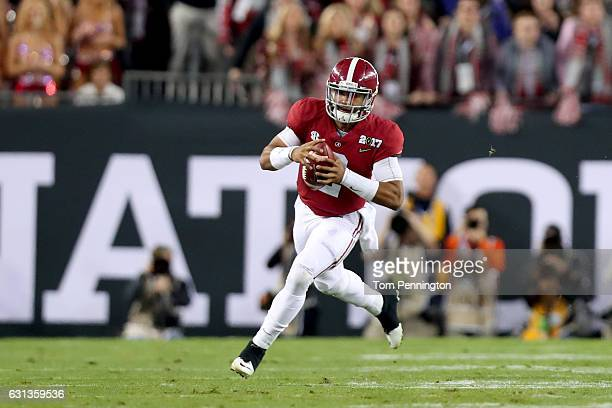 Quarterback Jalen Hurts of the Alabama Crimson Tide scrambles during the first half against the Clemson Tigers in the 2017 College Football Playoff...