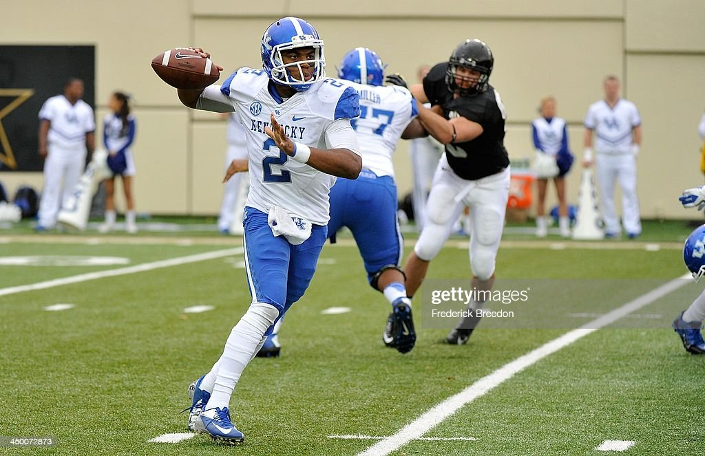 Quarterback Jalen Whitlow #2 of the Kentucky Wildcats rolls out to throw a pass against the Vanderbilt Commodores at Vanderbilt Stadium on November 16, 2013 in Nashville, Tennessee.